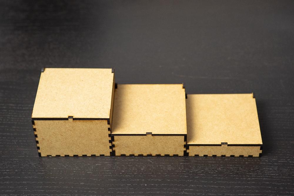 Cajas originales cortadas a láser en madera con grabado